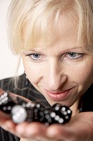 Businesswoman looking at dices on her palm