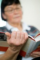 Senior woman reading book (thumbnail)