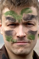 Soldier with camouflage grease on face