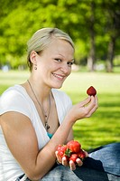 Woman posing with strawberries