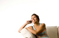 Woman smiling while talking on the mobile phone