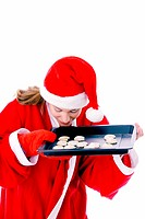 Woman smelling freshly baked cookies in a tray (thumbnail)