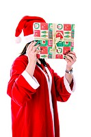 Woman in santa suit covering face with a gift