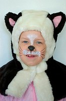 Girl with her face painted wearing cat's costume