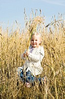 Girl posing at wheat field