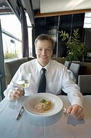 Businessman enjoying his meal at the restaurant (thumbnail)