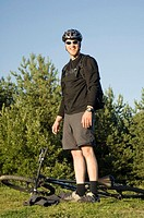 Man with sunglasses posing with his bicycle lying on the grass (thumbnail)