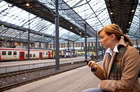 Woman text messaging while waiting for the train (thumbnail)