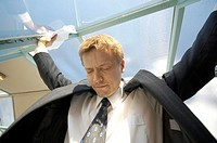 Businessman closing his eyes while looking down