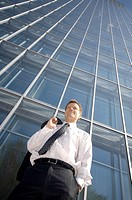 Businessman smiling while looking away (thumbnail)