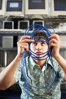 Technician Looking at Networking Cable