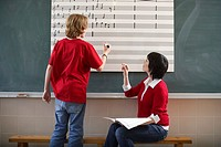 Teacher Assisting Student