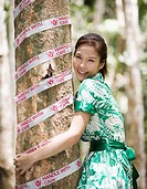 Environmentalist Hugging Tree