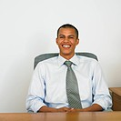 Mixed Race businessman sitting at desk
