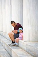 Father sitting with daughter in  Athens. Greece.