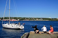 Harbour, Girls watching a sailboat. Halifax. Nova Scotia. Canada
