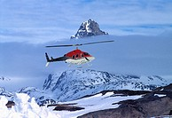 Helicopter in front of mountain. Tasiilaq. Greenland