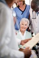 Senior Woman Talking with Medical Team