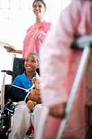 Nurse Pushing Young Boy in a Wheelchair (thumbnail)