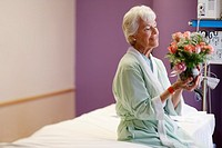 Senior Woman Holding Bouquet