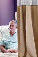 Middle Aged Man in Hospital Bed