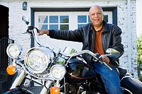Senior African American man sitting on motorcycle