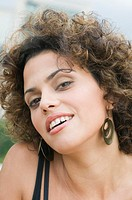 Close up of Hispanic woman smiling