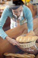 Deli Owner With Fresh Bread (thumbnail)