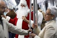 Man Wearing Santa Costume on Subway