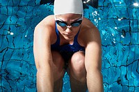 Swimmer Preparing to Dive in Pool