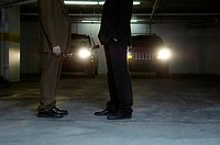 Businessmen meeting in a parking lot
