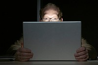 Man interested in the contents of a laptop computer