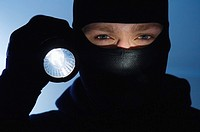 Thief holding a flashlight