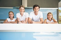 Family beside a swimming pool