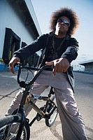 African male breakdancer on bicycle