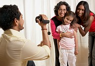 Indian father video recording family
