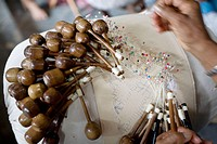 Craftsmanship, lace bobbin ( renda de bilro ), cultural traditions from Northeastern Brazil.