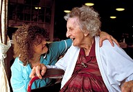 Geriatric care  Care worker talking with an elderly woman