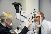 Eye examination  Patient having his eyes scanned by a fundus camera  This camera is non-mydriatic, meaning that it does not require the use of pupil-d...