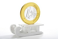 Euro coin on toy sledge (thumbnail)