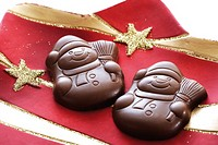 Chocolate snowmen on Christmas plate