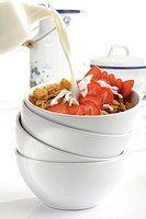 Cornflakes and strawberries in bowl, close-up