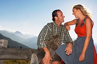 Couple on mountain pasture, portrait