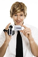 Man holding digital camera, close-up