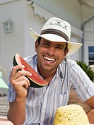 Man eating watermelon, close-up