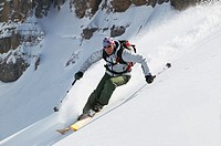 Austria, Kleinwalsertal, Man skiing in Alps