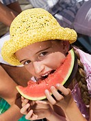 Girl eating watermelon, close-up