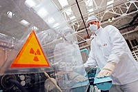 Nuclear fuel assembly at the Novosibirsk Chemical Concentrate Works, Russia  This is the anodizing stage where the uranium fuel is oxidised into a cer...