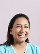 Mid_adult woman laughing