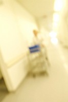 Technician pushing a trolley down a laboratory corridor
